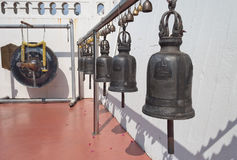 Old bells and gong on the Golden mountain temple in Bangkok Stock Photo