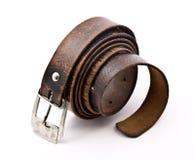 Old belt. Old battered belt on a white background stock images