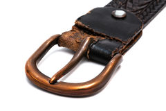 Old belt with copper buckle. On a white background Royalty Free Stock Photo
