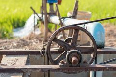 Free Old Belt Pulley Is Pumping Groundwater. Stock Photo - 116148720