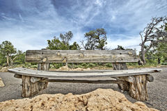 Old bench. Old wooden bench on the background of sky in grand canyon Stock Photo