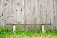 Old Bench Against Wooden Wall Royalty Free Stock Images