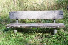 Old bench in Dolomiti mountains, Belluno region, Italy royalty free stock photo