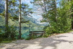 Old bench at lake Vorder Langbathsee in Austria Royalty Free Stock Photo
