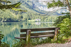 Old bench at lake Vorder Langbathsee in Austria Stock Photo