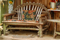 Old bench made of tree branches Royalty Free Stock Photography