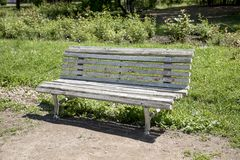Old bench in the park at summer. Vintage retro bench royalty free stock image