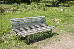 Old bench in the park at summer. Vintage retro bench stock image