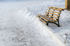 Old bench on a snow winter background Royalty Free Stock Image