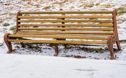 Old bench on a snow winter backgrounds. Old bench on a snow winter background Stock Photo