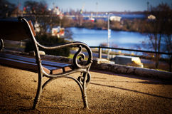The old bench stands over the Oder River. Poland. Szczecin. The old bench stands over the Oder River Royalty Free Stock Image
