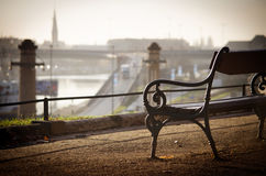 The old bench stands over the Oder River. Poland. Szczecin. The old bench stands over the Oder River Stock Photo