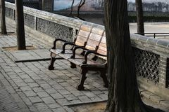 Old bench on the streets of Chinese cities. Stock Image