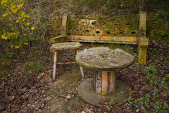 Old bench and table in forest. Old bench and table in a fairy tale like forest Royalty Free Stock Image