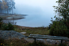 Old bench with view over lake Stock Image