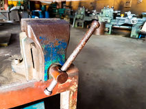 Old Bench Vise hand tool with rust on table Royalty Free Stock Photography