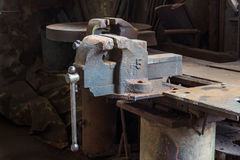 Old bench vise. Old and rusty bench vise in metalwork workshop stock images
