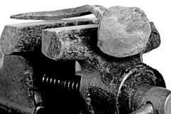 Old bench vise with rusty nail Stock Image