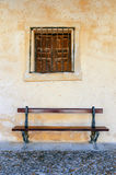 Old bench and window Stock Photography