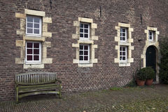 Old bench and windows on courtyard Castle Hoensbroek Stock Photography