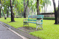 Old bench wooden in garden. Old green bench wooden in garden Stock Photo