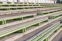 Old benches at the stadium royalty free stock photography