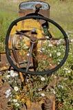 Old bent tractor steering wheel Stock Photos