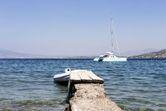 Old berth and yacht Royalty Free Stock Images