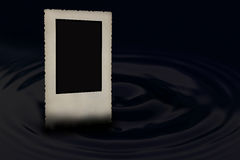 Old bevelled photo frame in the water wave Royalty Free Stock Photo
