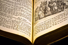 Old bible. Very old german bible on black Royalty Free Stock Images