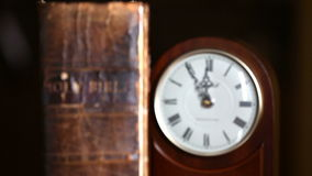 Old Bible and Antique Clock stock footage