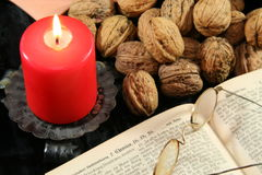 Old bible and christmas decoration. Christmas decoration with old book and nuts Royalty Free Stock Images