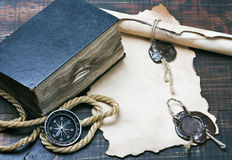 Old bible and a compass Royalty Free Stock Photos