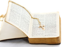 OLd Bible with cross. Bible with cross on white Stock Photography