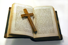 Old bible and cross. A very old bible with a cross in it Stock Photo
