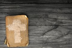 Old Bible and Cross of ash - symbols of Ash Wednesday. Religious Symbol Royalty Free Stock Photo