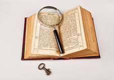Old Bible with magnifier Royalty Free Stock Images