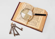 Old Bible with magnifier Royalty Free Stock Photos