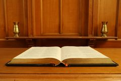 Old Bible open on communion table Stock Images