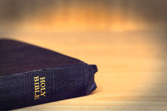 Old Bible over Grunge Timber Background.  Royalty Free Stock Image