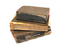 Old Bibles. A stack of old Bibles isolated on a white background Royalty Free Stock Photo
