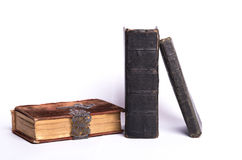 Old bibles. Three old bibles on a white background stock photo