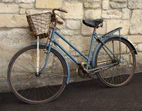 Old Bicycle. Vintage Bicycle Leaning against a Stone Wall Stock Photos