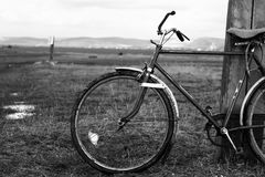 Old bicycle. Near against a pole Royalty Free Stock Images