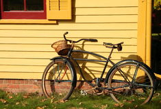 Old Bicycle. Old, antique, bicycle leaning against house wall Stock Photos
