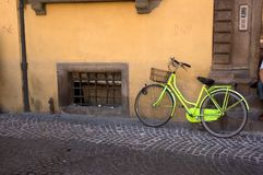 Old Bicycle. Old Yellow Bicycle Parked On An Italian Street Royalty Free Stock Photography