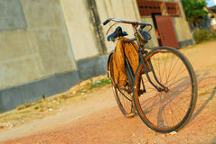 Old bicycle. Rusty old bicycle with shadow at sunset Stock Photography