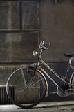Old Bicycle. Old fashioned bicycle by the wall Stock Photos