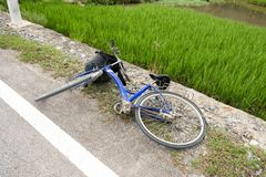 Bicycle accident fall on concrete road. Old bicycle accident fall on concrete road Royalty Free Stock Photo
