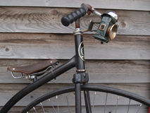 Old Bicycle against old wooden wall. Stock Photo